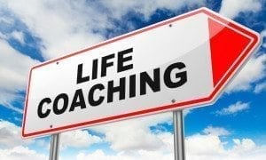 A picture of a sign post with an arrow pointing toward life coaching